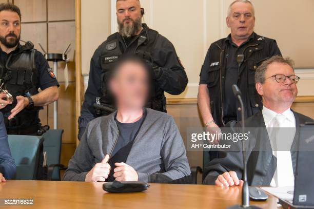 A former member of an IRA splinter group sits next to his defender Thomas Klein at the court in Osnabrueck central Germany on July 26 2017 A former...