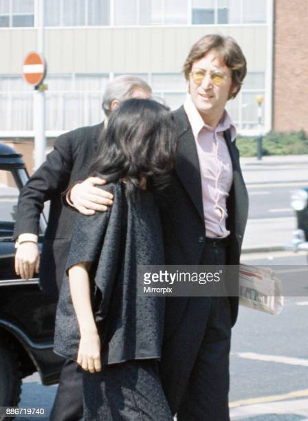 Former member of The Beatles pop group John Lennon with his wife Yoko Ono at Heathrow Airport London as they pass through from Trinidad on their way...