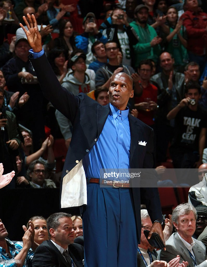Former member of the Boston Celtics <a gi-track='captionPersonalityLinkClicked' href=/galleries/search?phrase=Robert+Parish&family=editorial&specificpeople=208142 ng-click='$event.stopPropagation()'>Robert Parish</a> salutes the crowd as the Boston Celtics face the Minnesota Timberwolves during their NBA pre-season game at the Bell Centre on October 20, 2013 in Montreal, Quebec, Canada.
