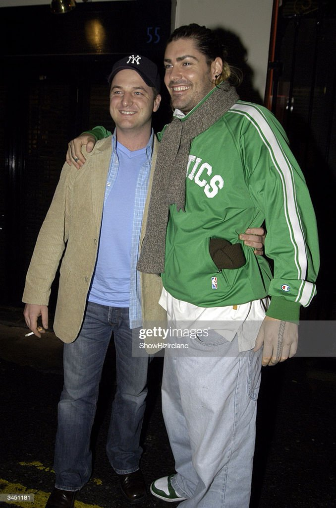 Former members of Boyzone, Shane Lynch (R) and Mikey Graham stand outside Diep Shaker Restaurant April 20, 2004 in Dublin, Ireland.