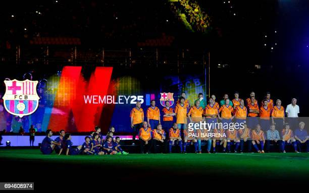 Former members of FC Barcelona's 'Dream team' pose during a tribute match against SL Benfica at the Camp Nou stadium in Barcelona on June 10 2017...