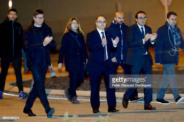 Former members of the Catalan government Carles Mundo Jordi Turull and Josep Rull leave Estremera prison on December 4 2017 near Estremera in Madrid...