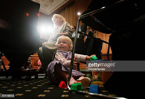 Former methamphetamine addict Aaronette Noble talks with her husband as her 15 month old daughter plays on the floor in the committee room before...