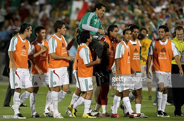 Former Mexico National Football team member Benjamn 'El Maestro' Galindo is carried off the field by current players of Mexico as he was honored...