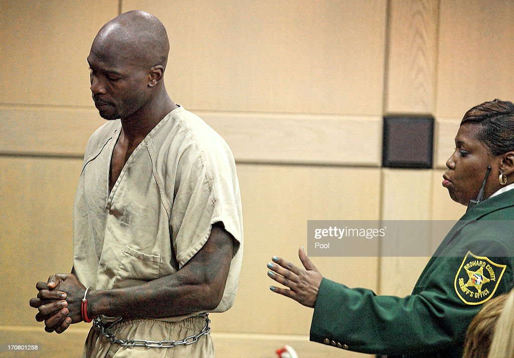 Former Miami Dolphin and NFL star Chad Johnson (L) is escorted into the courtroom at Broward County Courthouse on June 17, 2013 in Fort Lauderdale, Florida. The judge is reconsidering the 30-day jail term she imposed after playfully slapping his attorney on the rear end during a court hearing on June 10.