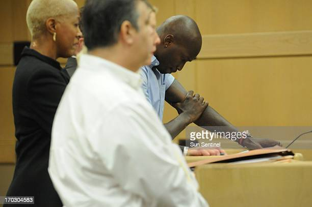 Former Miami Dolphins wide receiver Chad Johnson stands with his head down in court Monday June 10 after Broward Circuit Judge Kathleen McHugh...