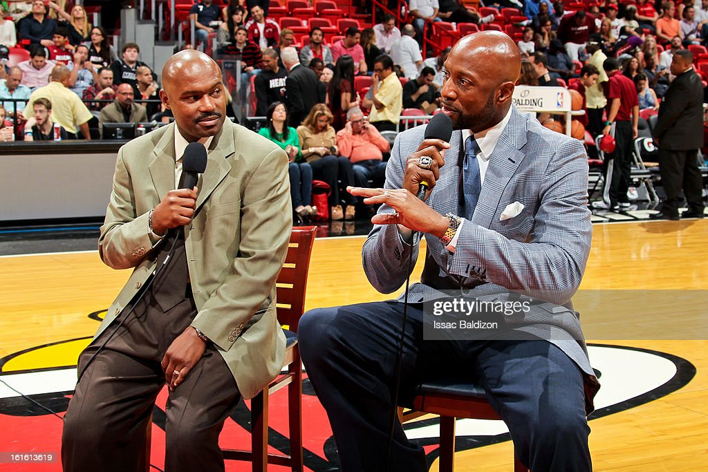 Former Miami Heat players Tim Hardaway, left, and Alonzo Mourning give an interview at halftime of a game between the Portland Trail Blazers and Heat on February 12, 2013 at American Airlines Arena in Miami, Florida.