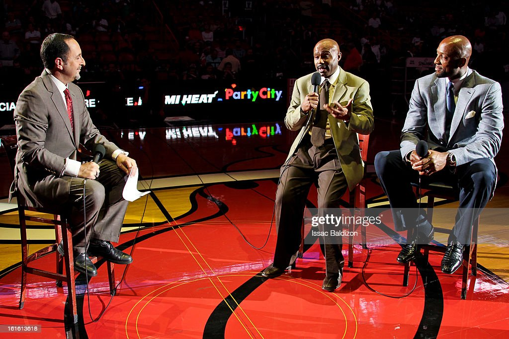 Former Miami Heat players Tim Hardaway, second right, and Alonzo Mourning, right, give an interview at halftime of a game between the Portland Trail Blazers and Heat on February 12, 2013 at American Airlines Arena in Miami, Florida.