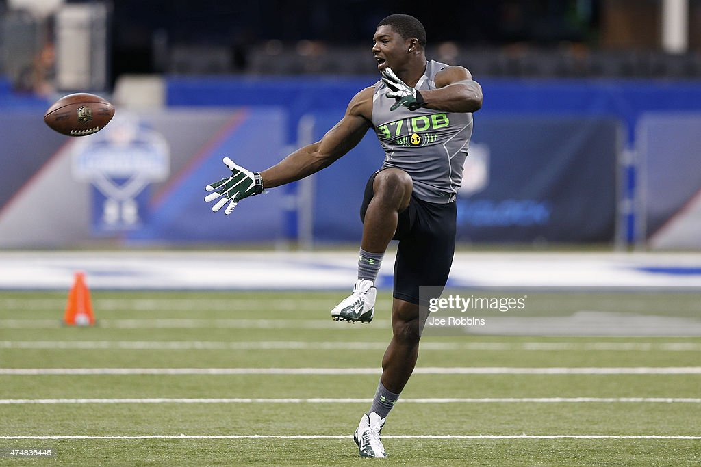 Former Michigan State defensive back Isaiah Lewis tries to catch the ball while running a drill during the 2014 NFL Combine at Lucas Oil Stadium on February 25, 2014 in Indianapolis, Indiana.