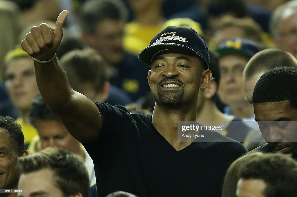 Former Michigan Wolverines player Juwan Howard supports Michigan against the Louisville Cardinals during the 2013 NCAA Men's Final Four Championship at the Georgia Dome on April 8, 2013 in Atlanta, Georgia.