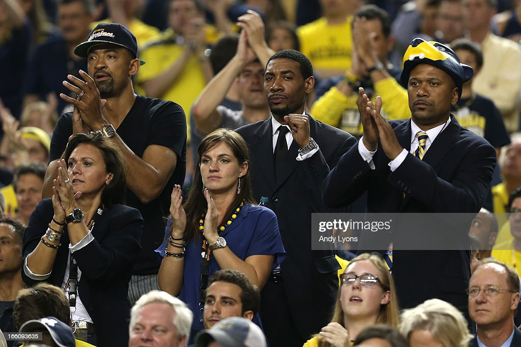 Former Michigan Wolverines players Juwan Howard, Jimmy King and Jalen Rose cheer for Michigan in the first half against the Louisville Cardinals during the 2013 NCAA Men's Final Four Championship at the Georgia Dome on April 8, 2013 in Atlanta, Georgia.