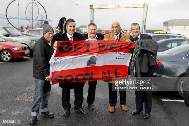 Former Middlesbrough players Bernie Slaven Paul Bracewell Curtis Fleming and Neil Maddison hold up a flag in support of Ali Brownlee before the match