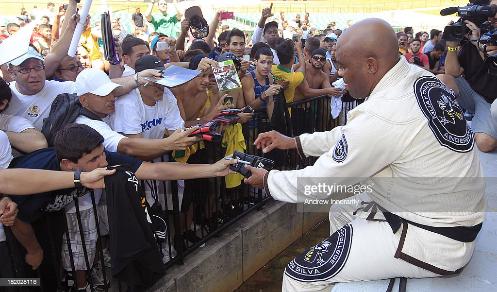 Former middleweight champion Anderson Silva signs autographs during the UFC 168: Weidman v SIlva 2 press tour at Klipsch Amphitheater at Bayfront Park on September 27, 2013 in Miami, Florida.