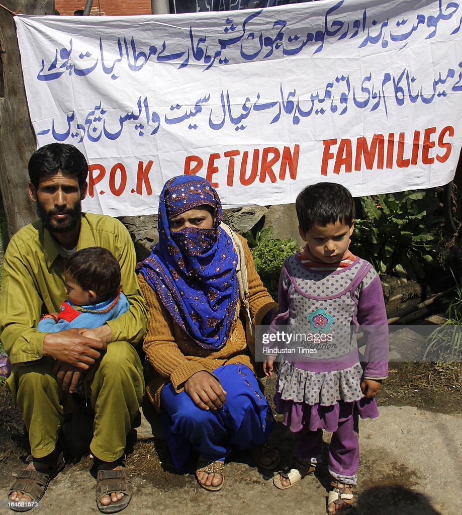 Former militants along with their families during a sit-in protest, on March 26, 2013 in Srinagar, India. More than 35 families of militants who returned home from Pakistan and surrendered under the Jammu and Kashmir government's rehabilitation policy staged protests here against the state and the central governments.
