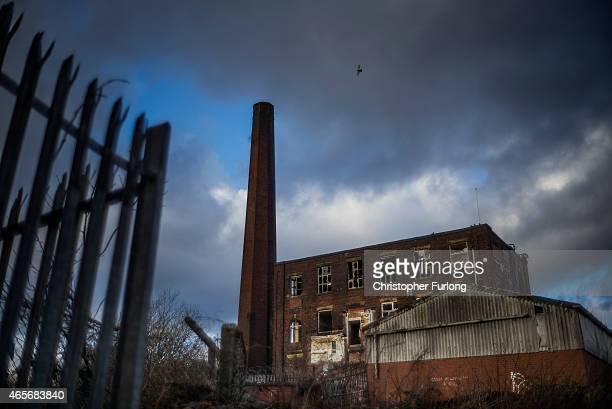 A former mill lays derelict waiting for redevelopment on March 3 2015 in Rochdale United Kingdom As the United Kingdom prepares to vote in the May...