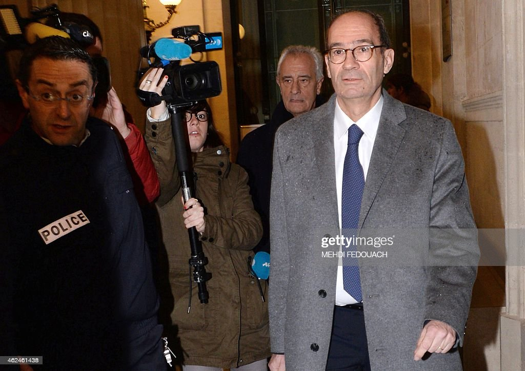 Former minister and former treasurer of the right-wing UMP party, Eric Woerth (R) arrives at the Bordeaux courthouse on January 29, 2015 for the 4th day of the trial of ten people charged with exploiting France's richest woman Liliane Bettencourt. 10 members of Bettencourt's entourage are accused of taking advantage of the 92-year-old billionaire's growing mental fragility in an explosive legal and political drama.