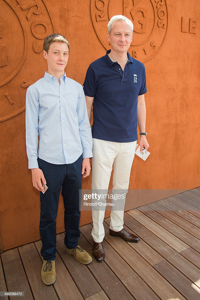 Former minister <a gi-track='captionPersonalityLinkClicked' href=/galleries/search?phrase=Bruno+Le+Maire&family=editorial&specificpeople=877418 ng-click='$event.stopPropagation()'>Bruno Le Maire</a> and his son attend the Roland Garros French Tennis Open 2014 - Day 15 at Roland Garros on June 8, 2014 in Paris, France.