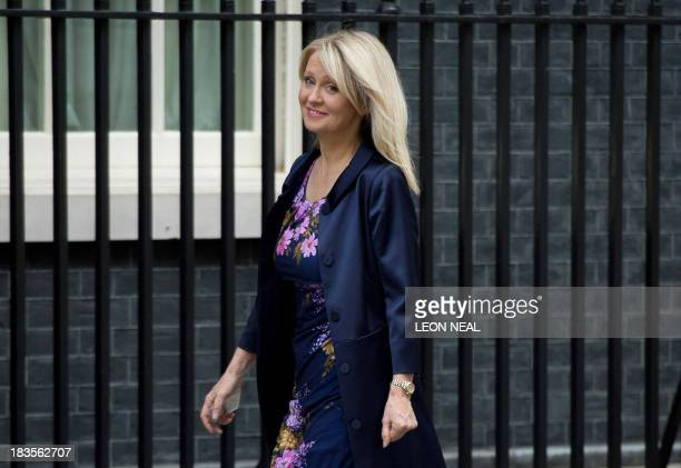 Former Minister for the Disabled Esther McVey arrives at 10 Downing Street in London on October 7 2013 McVey replaces Mark Hoban as Employment...