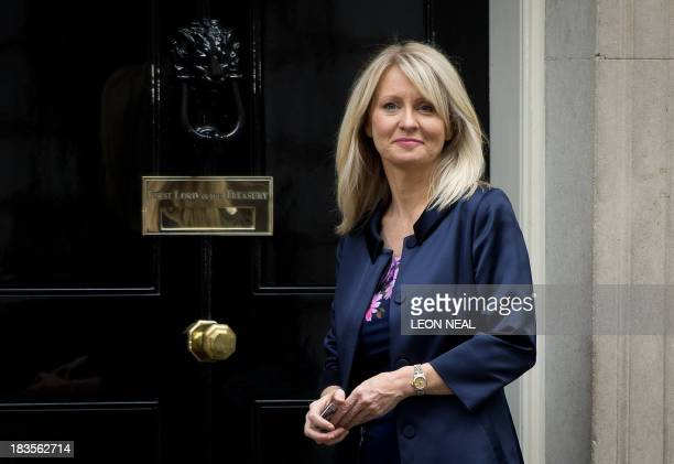 Former Minister for the Disabled Esther McVey poses for pictures outside 10 Downing Street in London on October 7 2013 McVey replaces Mark Hoban as...