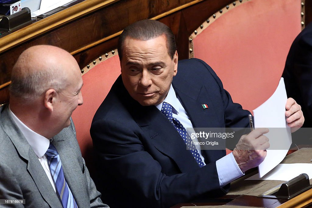 Former Minister of the Culture Sandro Bondi (L) and Silvio Berlusconi (R) attend the confidence vote at the Senate on April 30, 2013 in Rome, Italy. The new coalition government was formed through extensive cooperation agreements between the right and left coalitions after a two-month long post-election deadlock.