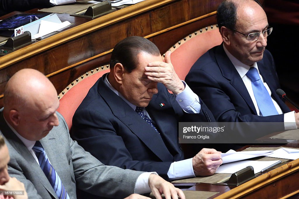 Former Minister of the Culture Sandro Bondi, Silvio Berlusconi and former president of the Senate Renato Schifani attend the confidence vote at the Senate on April 30, 2013 in Rome, Italy. The new coalition government was formed through extensive cooperation agreements between the right and left coalitions after a two-month long post-election deadlock.