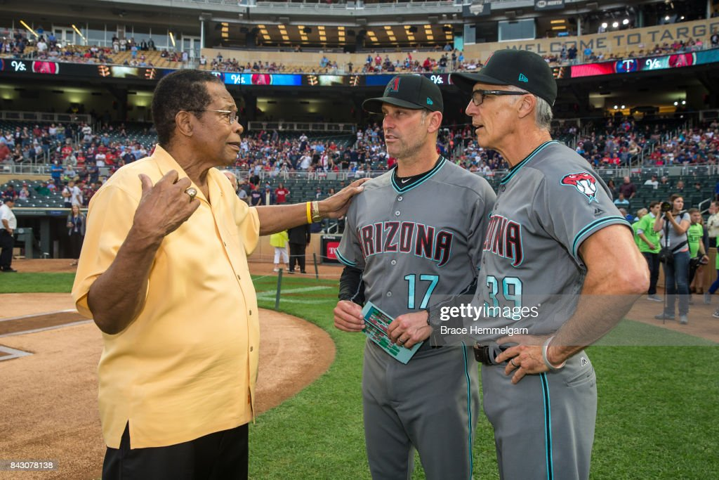Former Minnesota Twins and hall of fame player Rod Carew talks with manager Torey Lovullo #17 of the Arizona Diamondbacks and Dave McKay #39 prior to the game on August 18, 2017 at Target Field in Minneapolis, Minnesota. The Twins defeated the Diamondbacks 10-3.