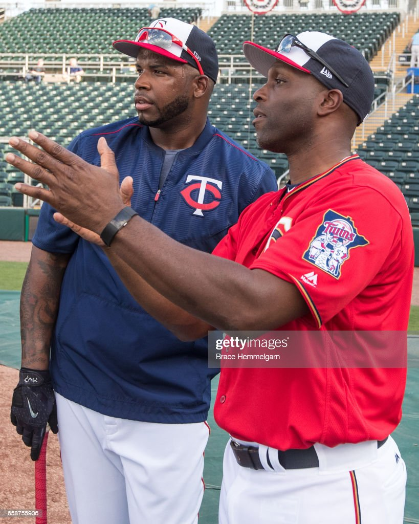 Former Minnesota Twins outfielder Torii Hunter #48 talks with Kennys Vargas #19 prior to a game against the Tampa Bay Rays on February 24, 2017 at the CenturyLink Sports Complex in Fort Myers, Florida.
