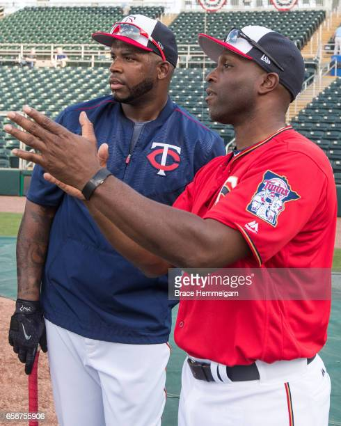 Former Minnesota Twins outfielder Torii Hunter talks with Kennys Vargas prior to a game against the Tampa Bay Rays on February 24 2017 at the...