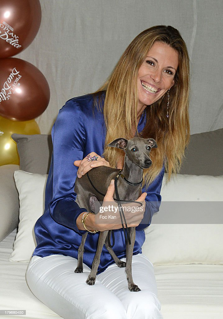 Former Miss France 1998/ TV presenter Sophie Thalmann and dog Helixir attend the Duo Delice Dog Food Launch Party at 6 Mandel on September 6, 2013 in Paris, France.