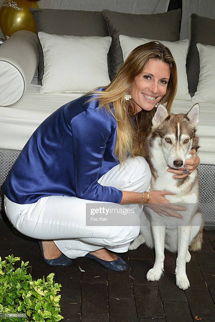 Former Miss France 1998/ TV presenter Sophie Thalmann and dog Tallula attend the Duo Delice Dog Food Launch Party at 6 Mandel on September 6, 2013 in Paris, France.