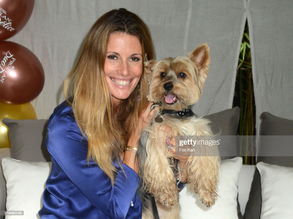 Former Miss France 1998/ TV presenter Sophie Thalmann and dog Voltaire attend the Duo Delice Dog Food Launch Party at 6 Mandel on September 6, 2013 in Paris, France.