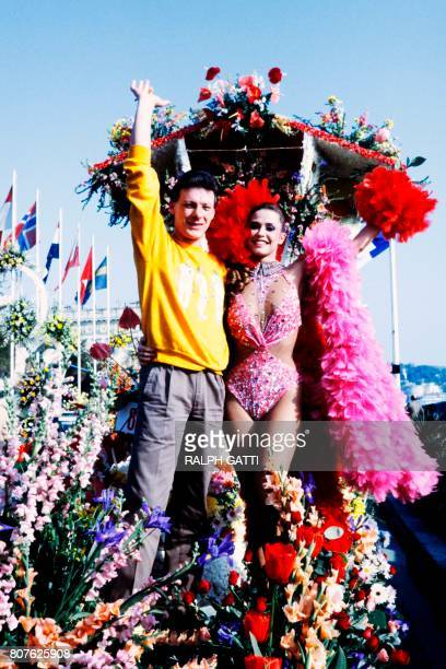 Former Miss France MarieChristine Pavani and French singer Herbert Leonard parade during the Carnaval of Nice southeastern France on February 6 1985...