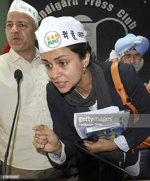 Former Miss India and actress Gul Panag candidate for Chandigarh Lok Sabha Seat AAP leader Manish Sisodia with other candidates from Punjab after a...