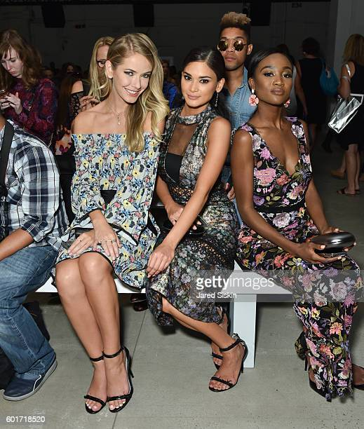 Former Miss USA 2015 Olivia Jordan Miss Universe Pia Wurtzbach and Miss USA 2015 Deshauna Barber backstage at the Nicole Miller Spring 2017 Fashion...