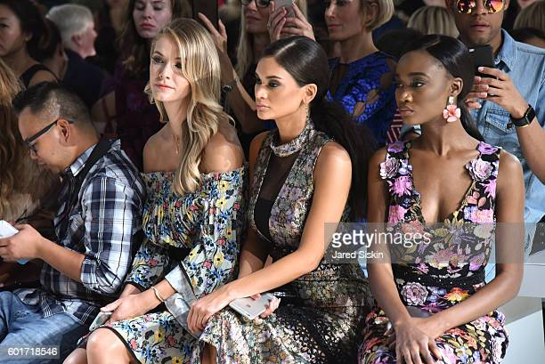 Former Miss USA 2015 Olivia Jordan Miss Universe Pia Wurtzbach and Miss USA 2015 Deshauna Barber sit front row at the Nicole Miller Spring 2017...