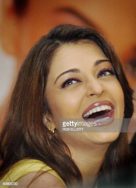 Former Miss World and Bollywood star Aishwarya Rai laughs at a press conference in Bombay 28 May 2004 The Indian superstar and worldwide brand...