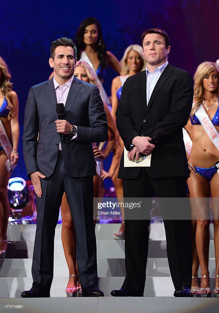 Former mixed martial artist Kenny Florian (L) and mixed martial artist Chael Sonnen host the 17th annual Hooters International Swimsuit Pageant at The Joint inside the Hard Rock Hotel & Casino on June 27, 2013 in Las Vegas, Nevada.