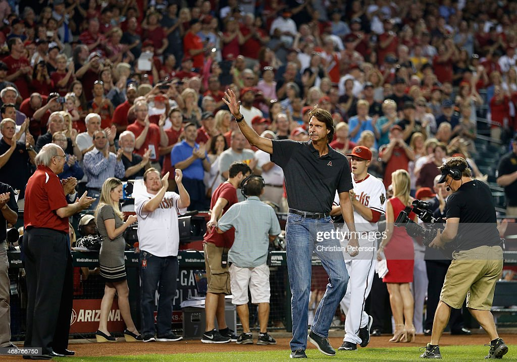 Former MLB pitcher Randy Johnson waves to fans as he takes the field for the ceremonial first pitch before the Opening Day MLB game between the Arizona Diamondbacks and the San Francisco Giants at Chase Field on April 6, 2015 in Phoenix, Arizona.