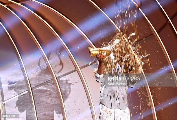 Former MLB player Derek Jeter gets slimed onstage at the Nickelodeon Kids' Choice Sports Awards 2015 at UCLA's Pauley Pavilion on July 16 2015 in...