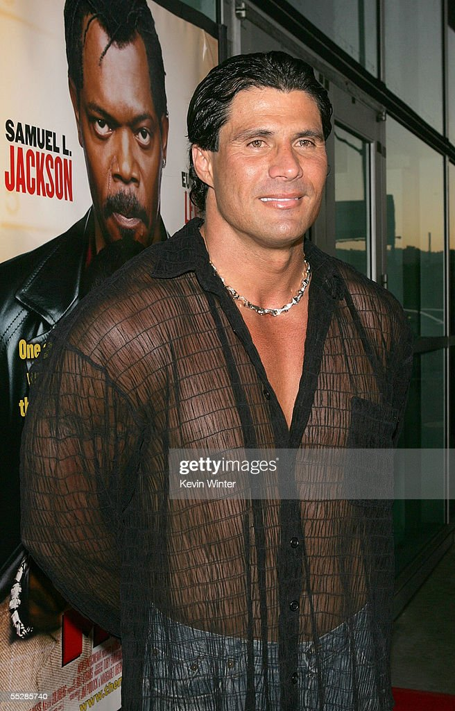 Former MLB player <a gi-track='captionPersonalityLinkClicked' href=/galleries/search?phrase=Jose+Canseco&family=editorial&specificpeople=203063 ng-click='$event.stopPropagation()'>Jose Canseco</a> arrives at the premiere of 'The Man' at the ArcLight Cinerama Dome on September 6, 2005 in Los Angeles, California.