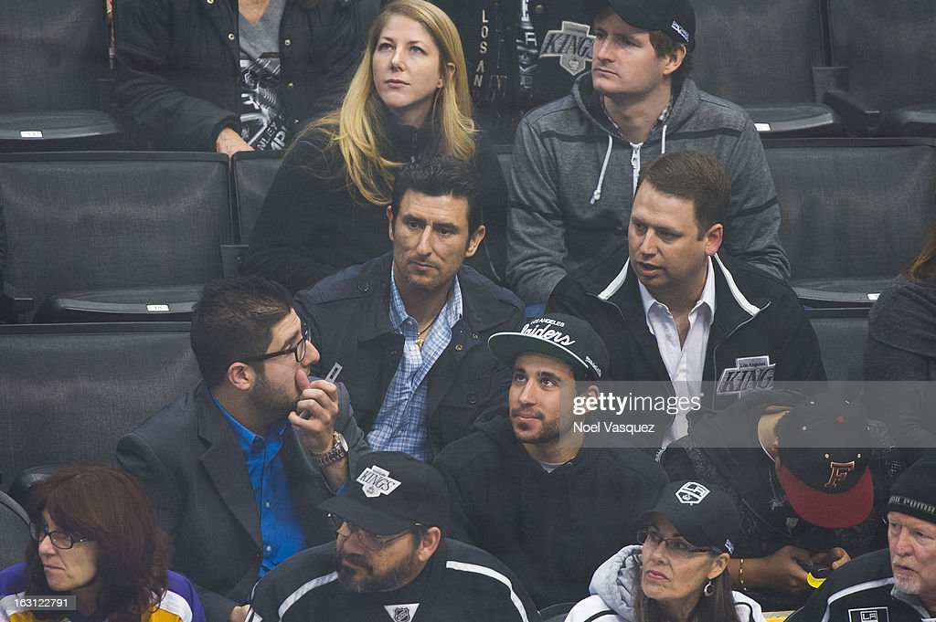 Former MLB player <a gi-track='captionPersonalityLinkClicked' href=/galleries/search?phrase=Nomar+Garciaparra&family=editorial&specificpeople=202512 ng-click='$event.stopPropagation()'>Nomar Garciaparra</a> (C) attends a hockey game between the Nashville Predators and Los Angeles Kings at Staples Center on March 4, 2013 in Los Angeles, California.