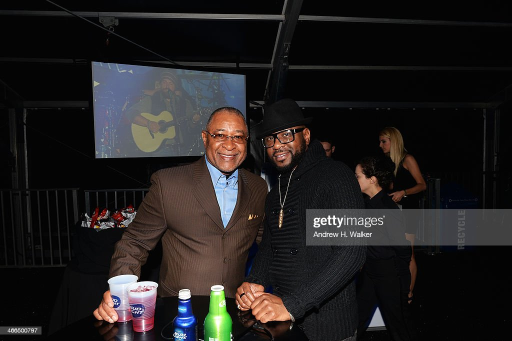 Former MLB player <a gi-track='captionPersonalityLinkClicked' href=/galleries/search?phrase=Ozzie+Smith&family=editorial&specificpeople=209214 ng-click='$event.stopPropagation()'>Ozzie Smith</a> (L) and singer Nikko Smith attend the Bud Light Hotel on February 1, 2014 in New York City.