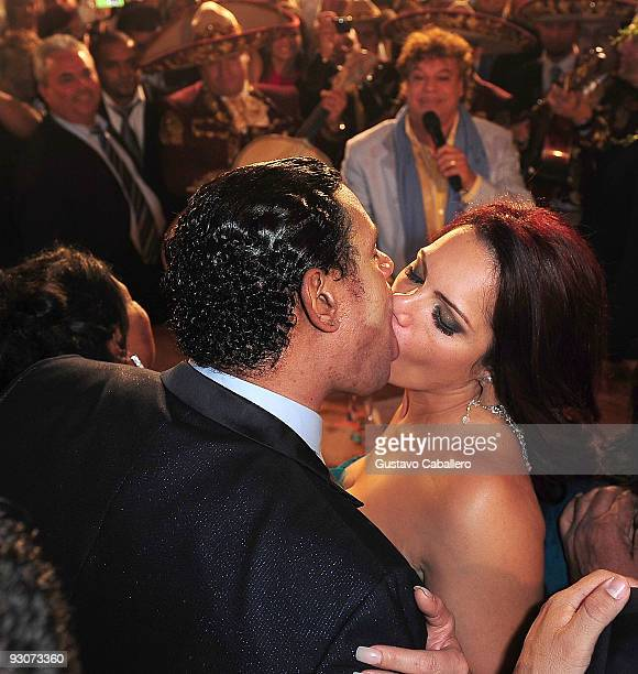 Former MLB player Sammy Sosa and Sonia Sosa kiss while Juan Gabriel sings to them at Sammy Sosa's birthday party at Fontainebleau Miami Beach on...
