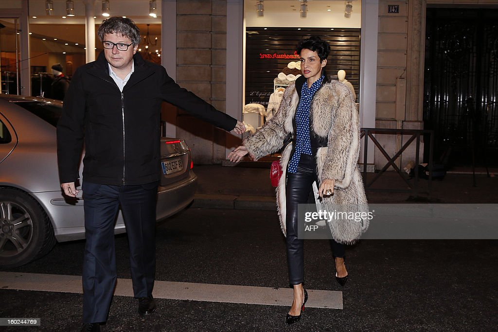 Former model Farida Khelfa and her husband Henri Seydoux arrive at the restaurant Rebelatto for a diner to celebrate the 58th birthday of French former President Nicolas Sarkozy, on January 28, 2013 in Paris. AFP PHOTO KENZO TRIBOUILLARD
