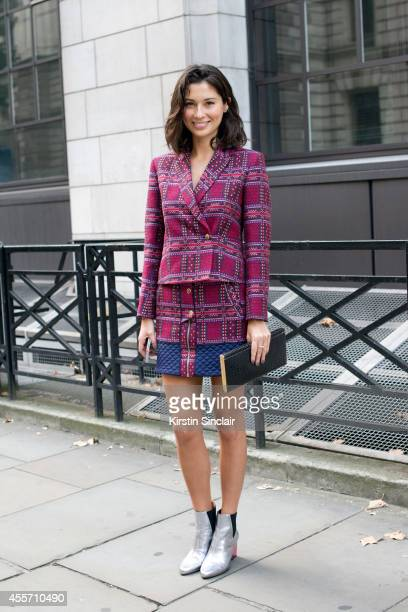 Former Model Jasmine Hemsley is wearing United Nude shoes Matthew Williamson top and skirt and vintage bag on day 3 of London Collections Women on...