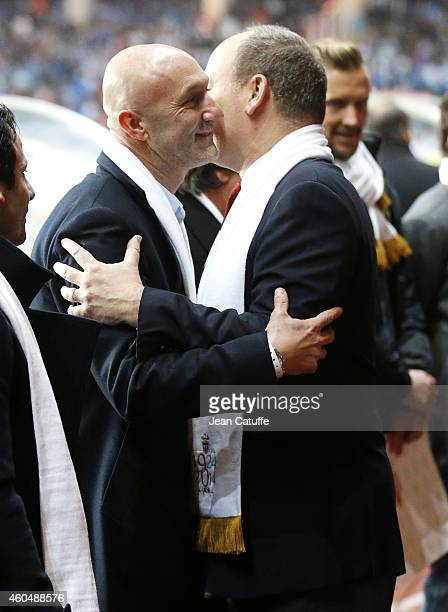 Former Monaco's player Fabien Barthez salutes Prince Albert II of Monaco during the 90th club's anniversary tribute prior to the French Ligue 1 match...