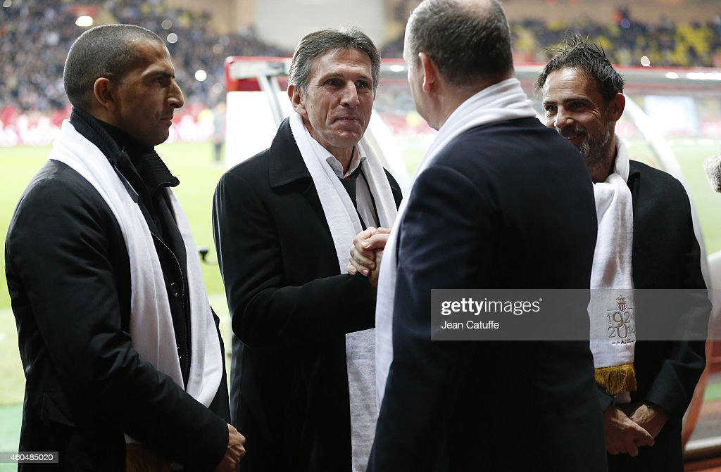 Former Monaco's players <a gi-track='captionPersonalityLinkClicked' href=/galleries/search?phrase=Sabri+Lamouchi&family=editorial&specificpeople=648801 ng-click='$event.stopPropagation()'>Sabri Lamouchi</a> and <a gi-track='captionPersonalityLinkClicked' href=/galleries/search?phrase=Claude+Puel&family=editorial&specificpeople=697176 ng-click='$event.stopPropagation()'>Claude Puel</a> salute <a gi-track='captionPersonalityLinkClicked' href=/galleries/search?phrase=Prince+Albert+II+of+Monaco&family=editorial&specificpeople=201707 ng-click='$event.stopPropagation()'>Prince Albert II of Monaco</a> during the 90th club's anniversary tribute prior to the French Ligue 1 match between AS Monaco FC v Olympique de Marseille OM at Stade Louis II on December 14, 2014 in Monaco.