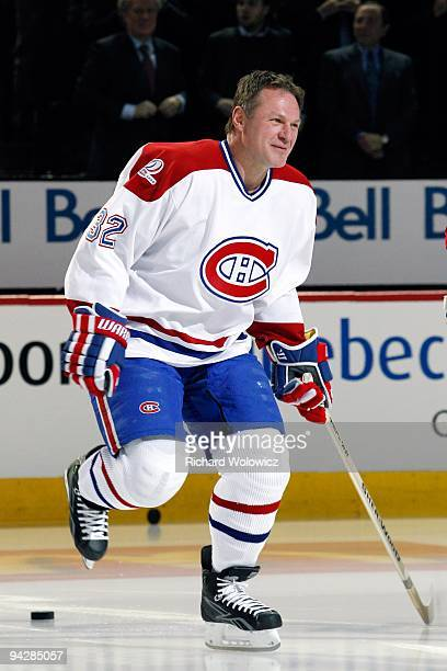 Former Monreal Canadien Claude Lemieux skates during the Centennial Celebration ceremonies prior to the NHL game between the Montreal Canadiens and...