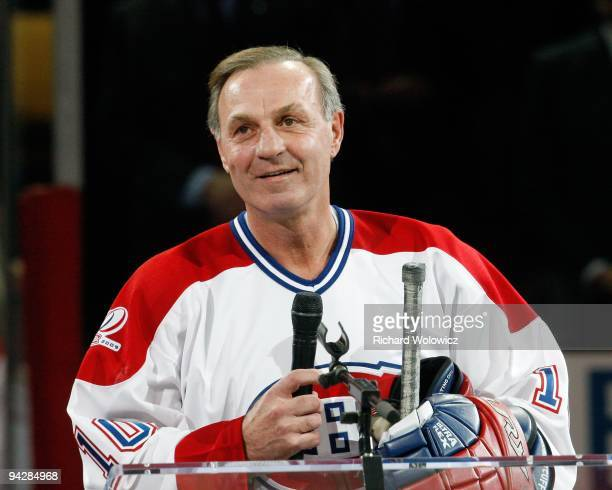 Former Montreal Canadien Guy Lafleur speaks to fans during the Centennial Celebration ceremonies prior to the NHL game between the Montreal Canadiens...