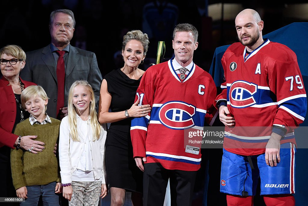 Former Montreal Canadien player <a gi-track='captionPersonalityLinkClicked' href=/galleries/search?phrase=Saku+Koivu&family=editorial&specificpeople=202253 ng-click='$event.stopPropagation()'>Saku Koivu</a> poses for a photo with family and former teammates during a ceremony honouring the former team captain prior to the NHL game between the Montreal Canadiens and the Anaheim Ducks at the Bell Centre on December 18, 2014 in Montreal, Quebec, Canada.